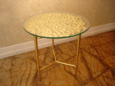 Side Table in gold colour with glas on the top